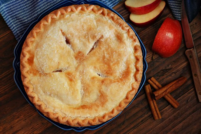Apple pie with cinnamon sticks