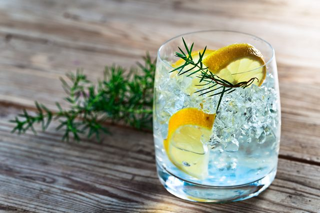 Gin cocktail with lemon and juniper