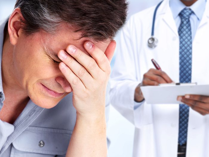 Man with headache going to the doctor