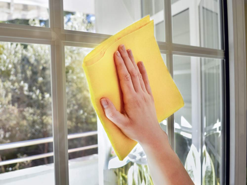 Cleaning window with cloth