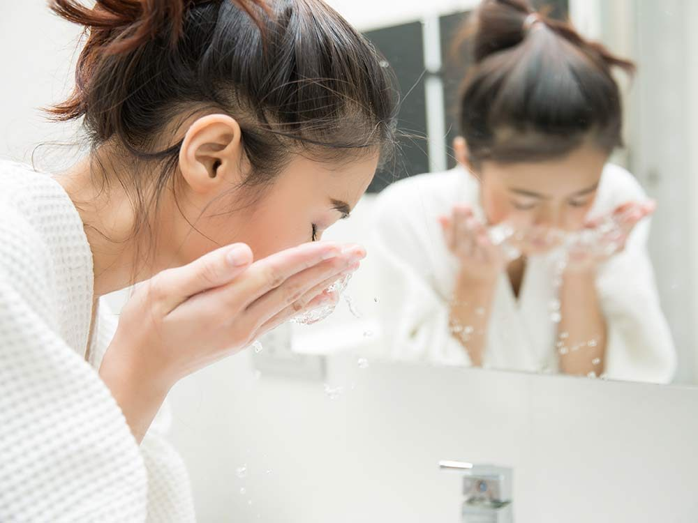 Woman washing face in the morning