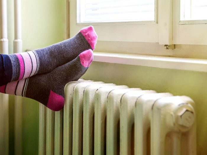 Feet on radiator