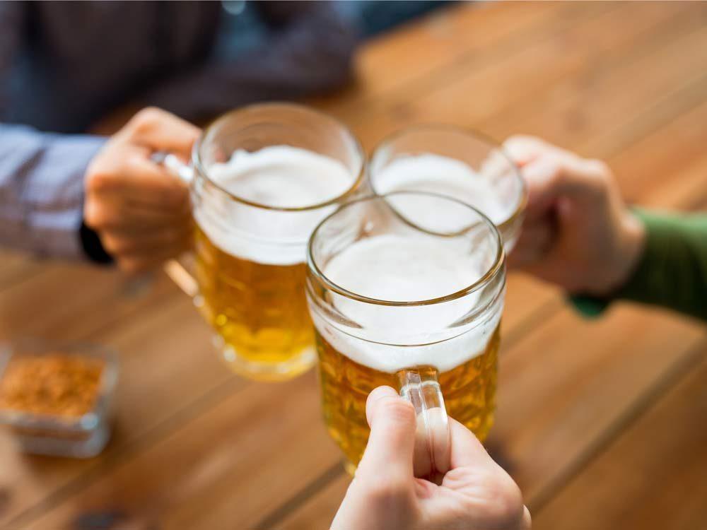Three friends enjoying beers