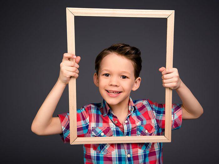 Kid holding frame