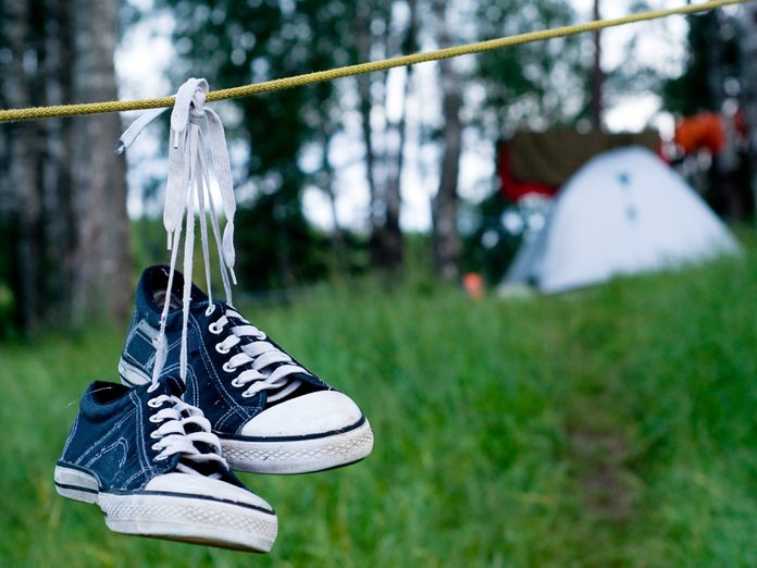 Shoes hanging from a campsite clothesline