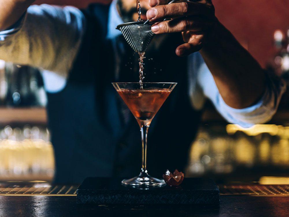 Bartender creating cocktail