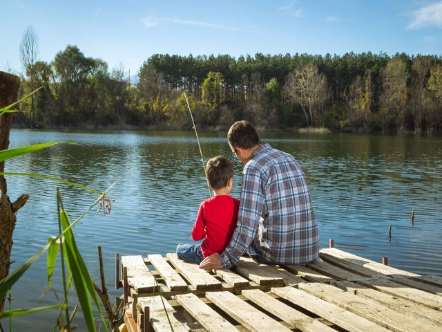 Father and son at the dock fishing