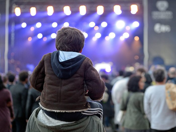 Father and son at a music concert