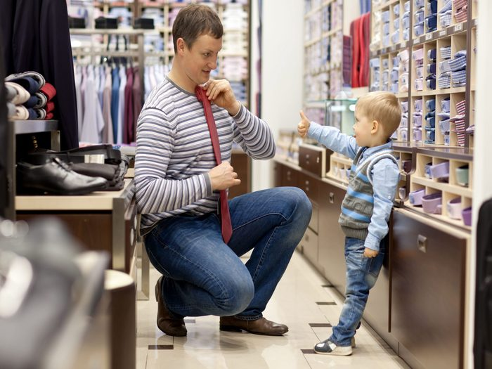Son helping his father pick out a tie
