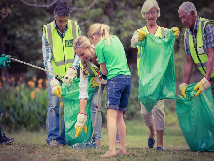 Family volunteering to clean garbage on Father's Day