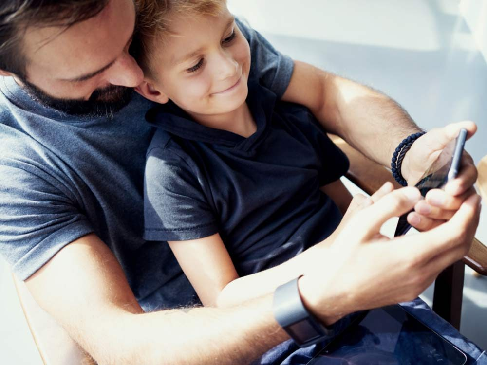 Father and son using smartphone