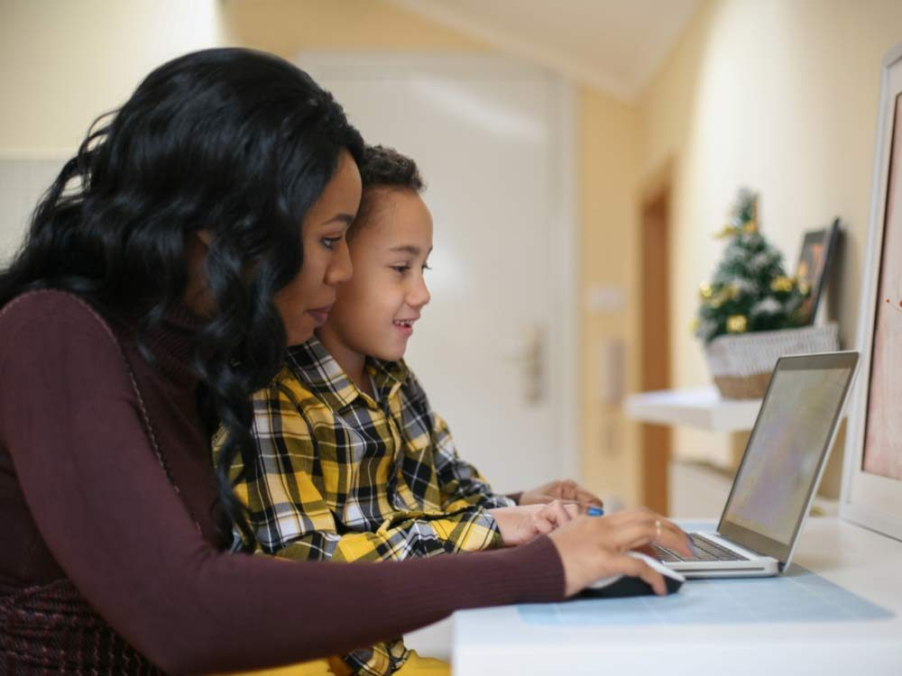 Mother and son on laptop
