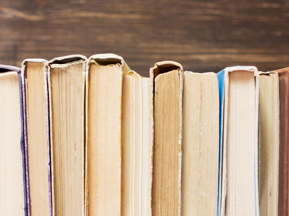 Books on wooden background
