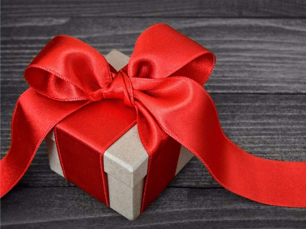 Gift box tied with red ribbon