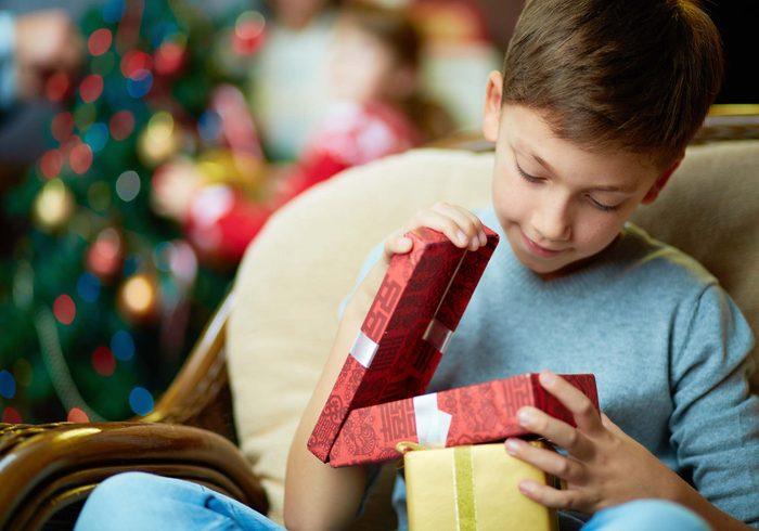 Boy looking into giftbox