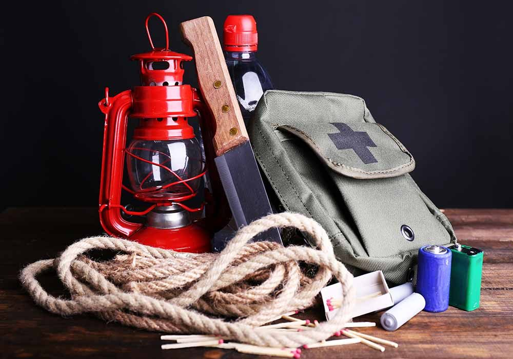 Emergency kit with rope, knife, batteries and water bottle