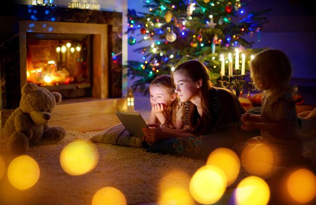 Children watching movies on tablet during Christmas