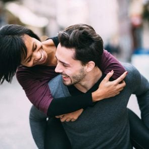 How to make a relationship last - man and woman piggyback