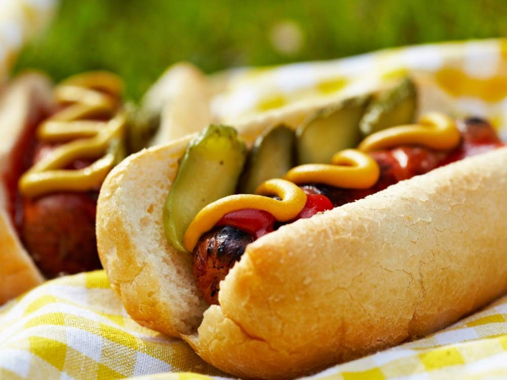 Hot dog with mustard and pickles
