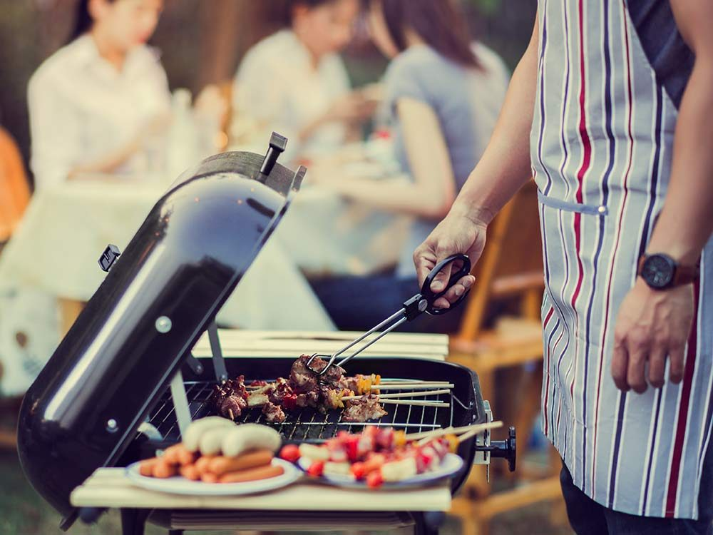 Man grilling food on barbecue