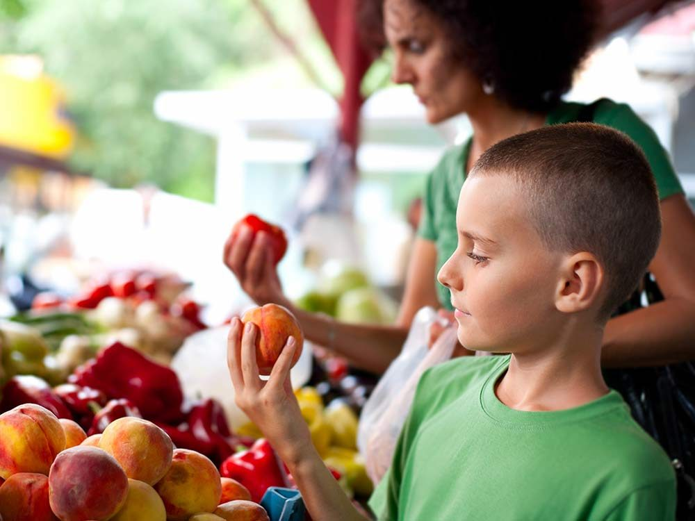 Mother and son shopping at farmer's market