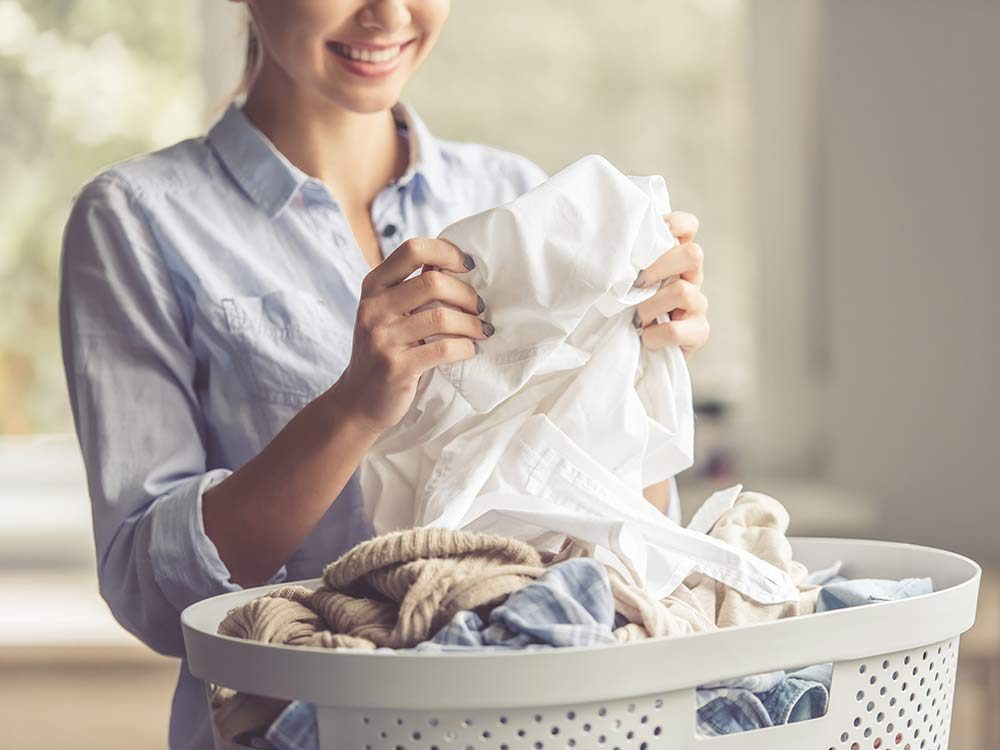 Woman folding her laundry
