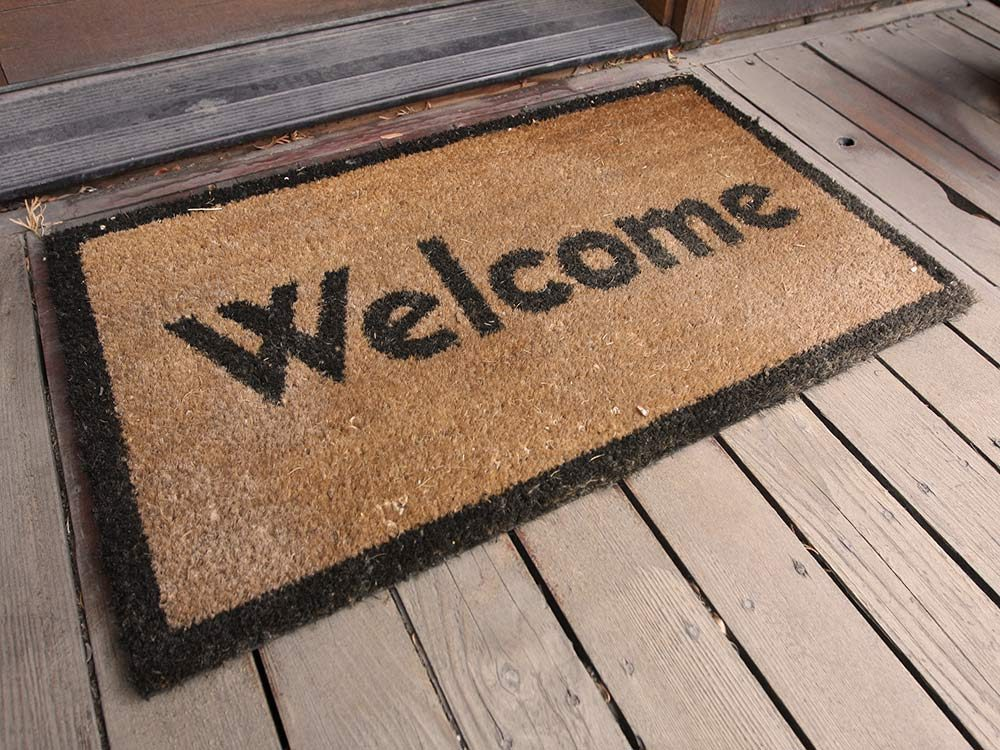 Welome doormats on front porch