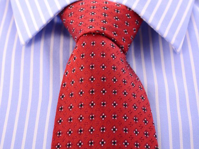Polka dot tie on striped shirt