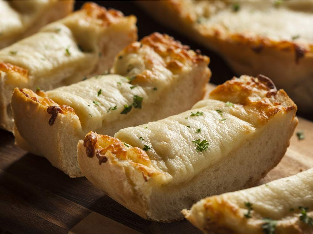 Garlic bread with cheese and parsley