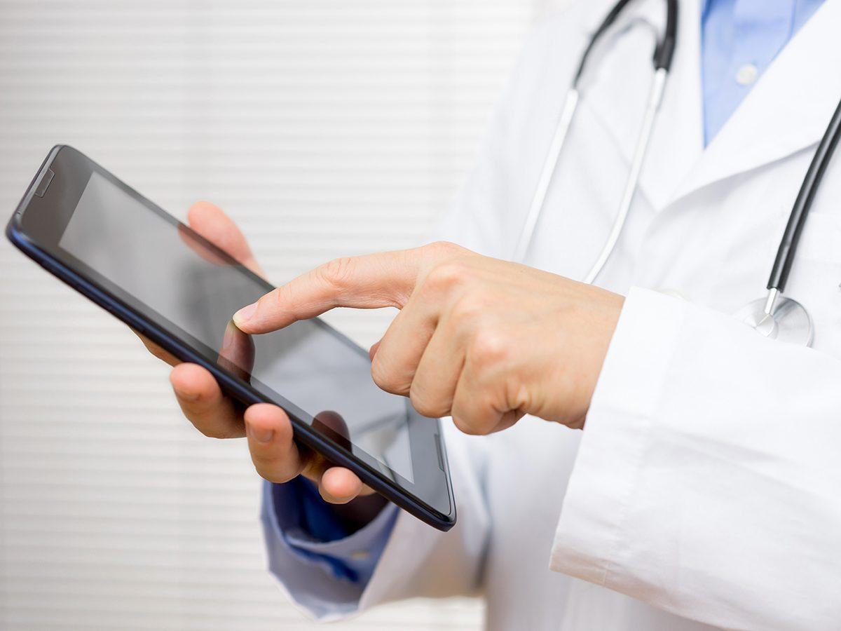 Doctor checking ipad
