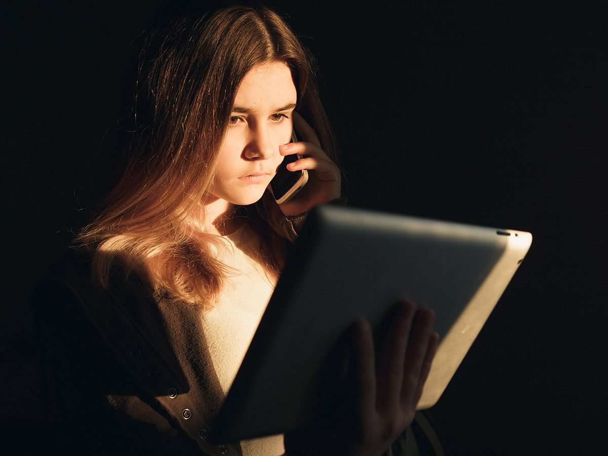Is Google making you sick? Sad young woman on laptop
