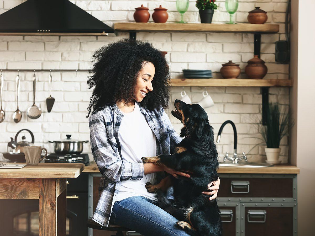 Homemade dog food recipes - woman and dog