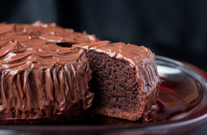 Chocolate mud cake being sliced