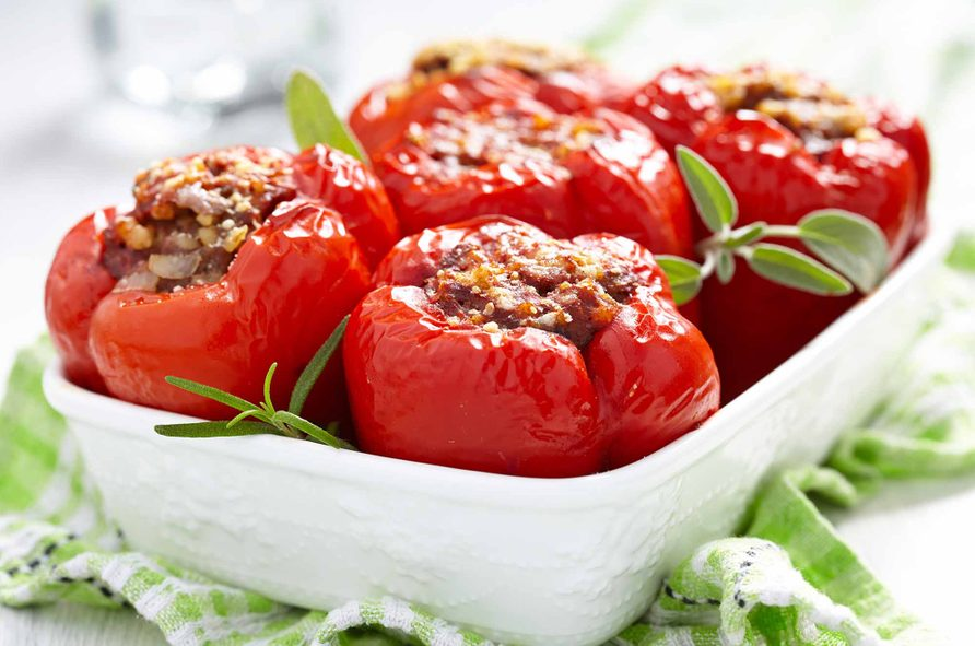 Red bell peppers stuffed with chicken