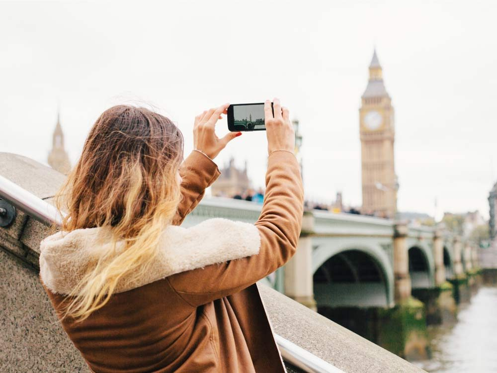 Woman taking photos in London