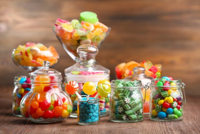 Colourful assorted candies in jars