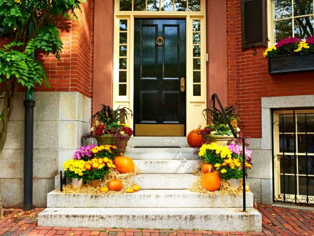 Pumpkins on porch during Halloween season