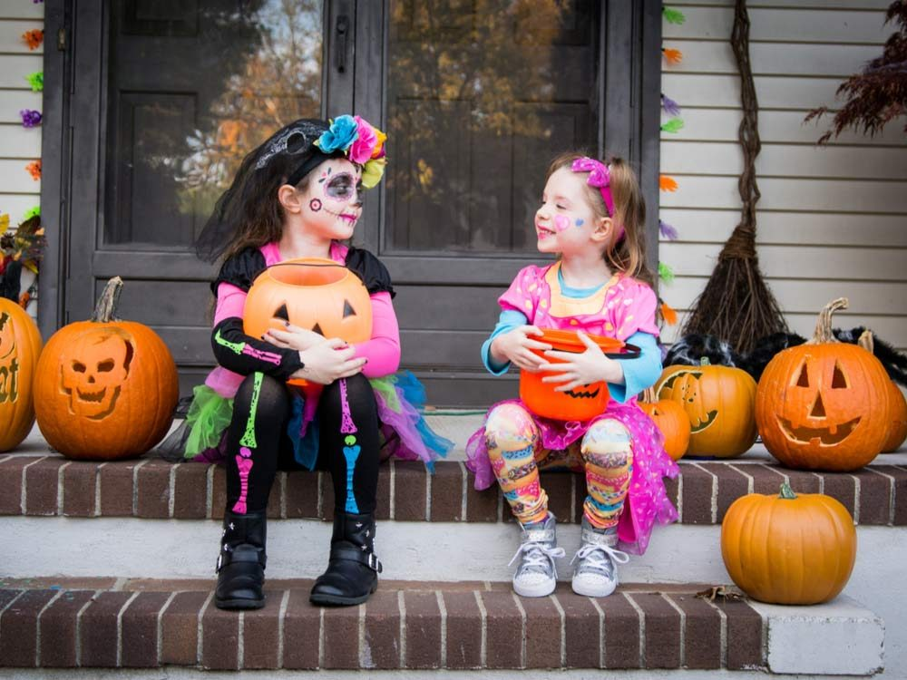 Halloween sisters on porch