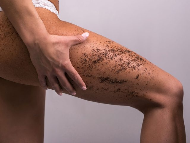 Coffee ground on woman's upper leg