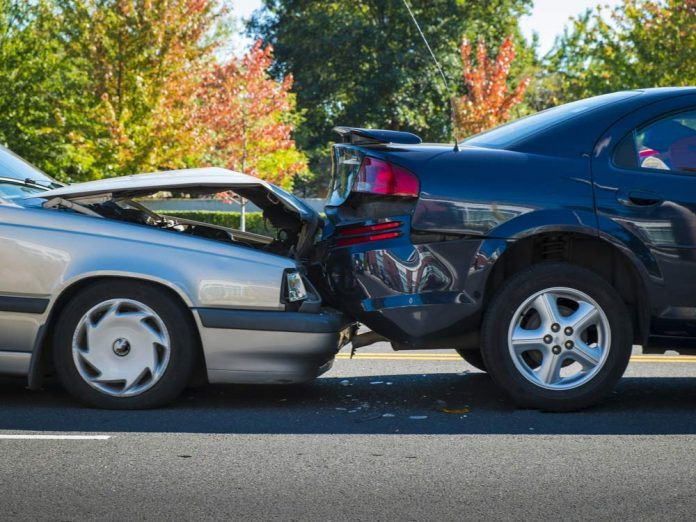 Auto accident involving two cars on street