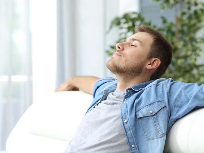 how to get rid of toxic friends - man relaxing on sofa
