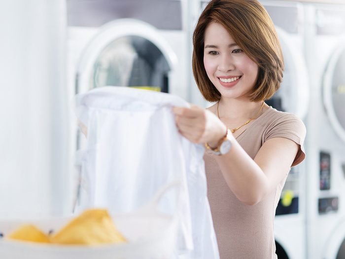 Things to do with toothpaste - woman doing laundry