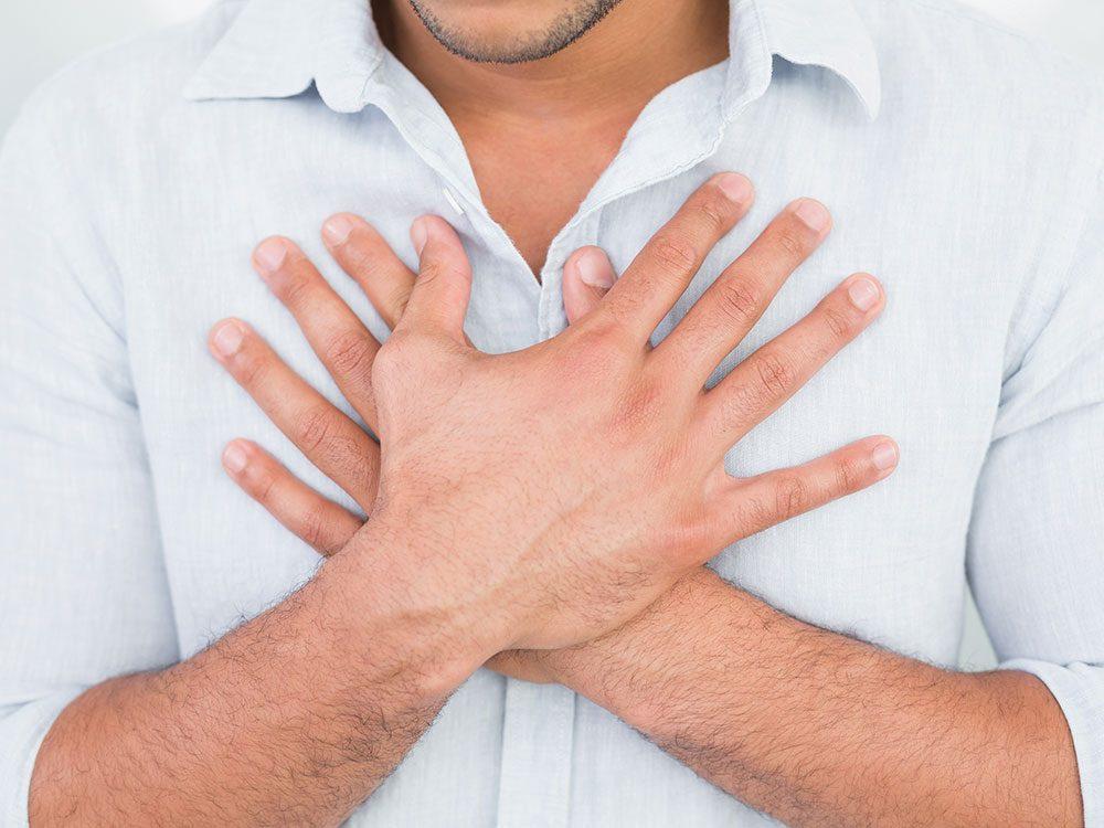 Man suffering from heartburn