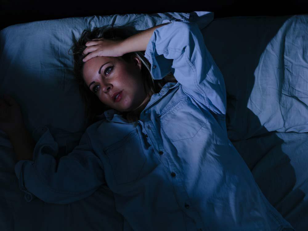 Woman laying awake at night