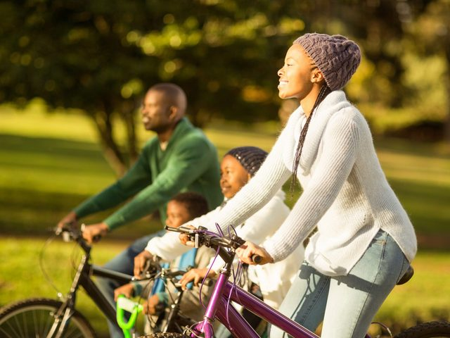 African-American family going on a bike ride