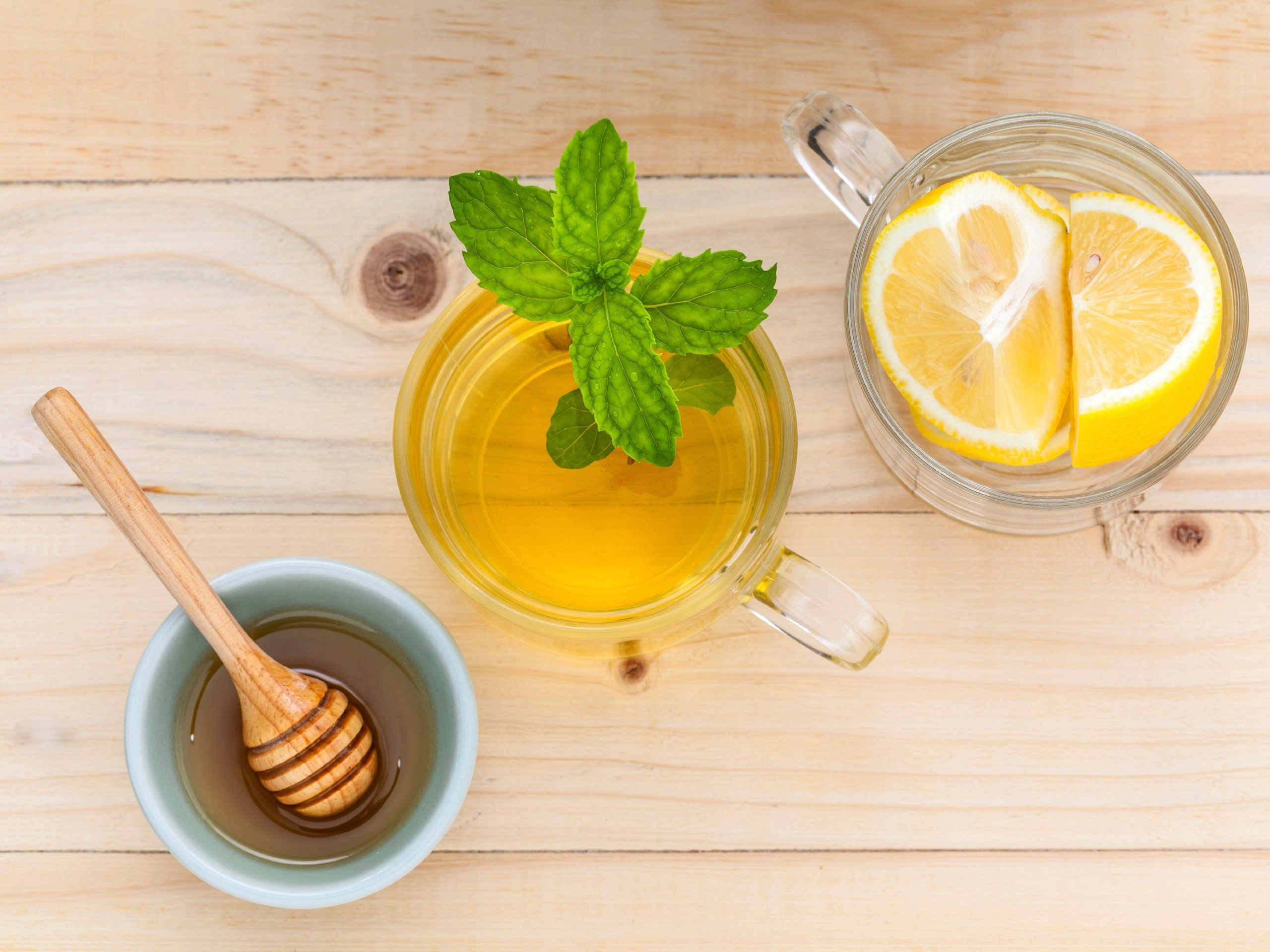 8. Soothe sore throats with honey and lemon