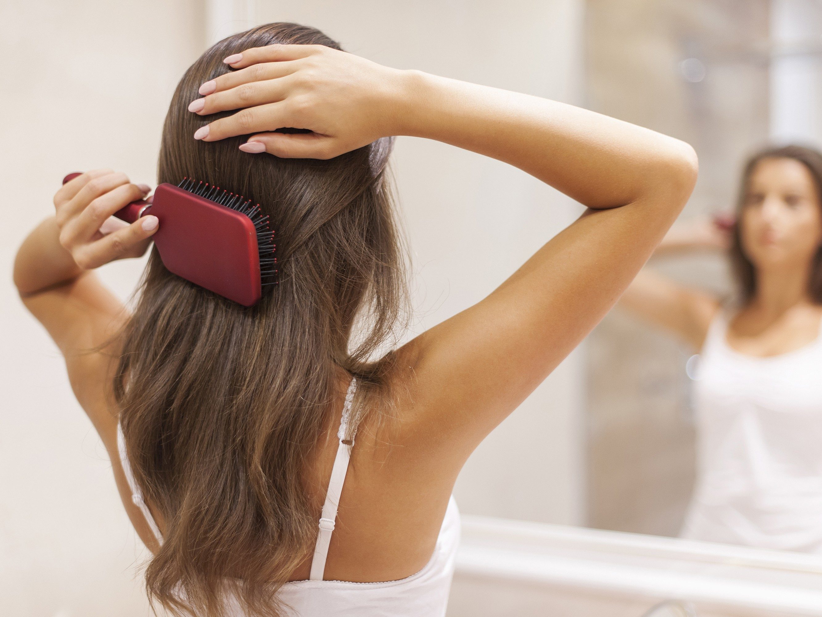 Dandruff solution #3: Brush your hair (a lot)