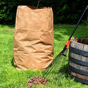 2. Hold Leaf Bag Open