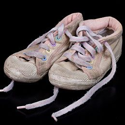 Use Old Socks to Cover Kids' Shoes When Packing