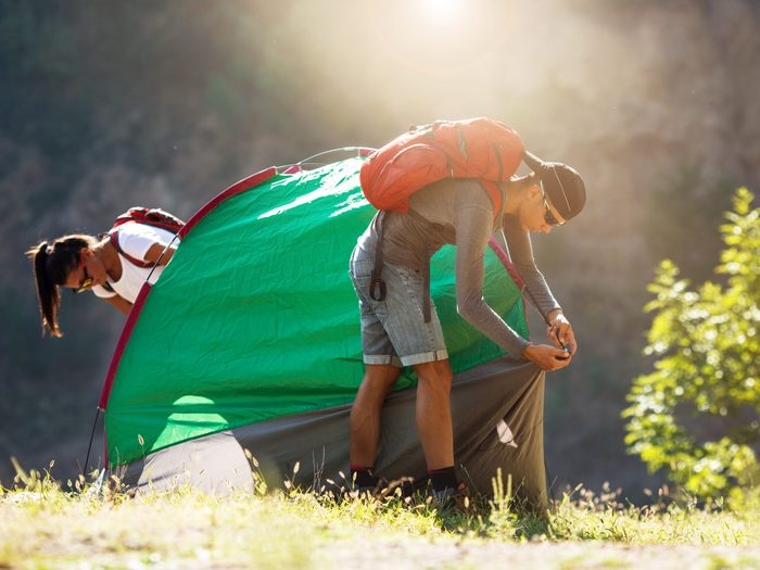 Setting up tent at campsite
